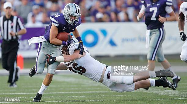 Missouri State linebacker Tim Piccareto has Kansas State wide receiver Curry Sexton slip out of his grasp after Sexton caught a Collin Klein pass in...