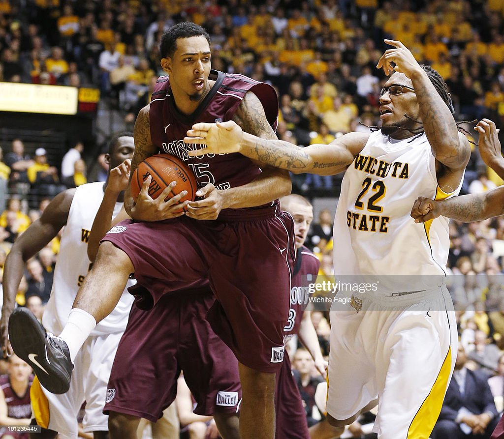 Missouri State's Drew Wilson pulls down a rebound against Wichita State's Carl Hall (22) in the first half at Koch Arena in Wichita, Kansas, on Saturday, February 9, 2013.