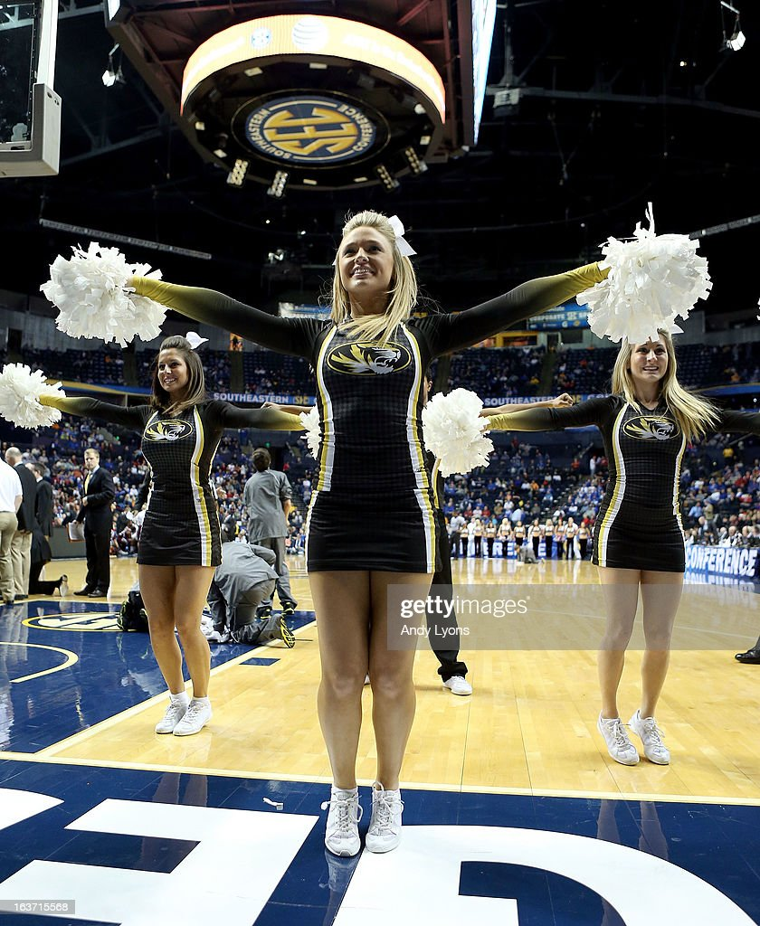 Missouri Tigers cheerleaders perform during the game against the Texas A&M Aggies in the second round of the SEC Basketball Tournament at Bridgestone Arena on March 14, 2013 in Nashville, Tennessee.