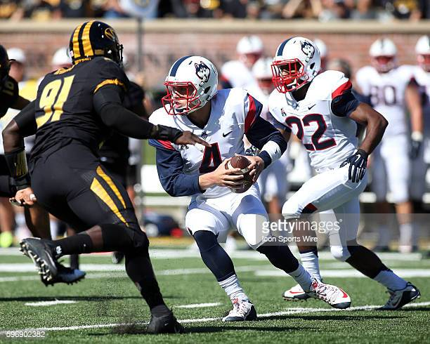 Missouri Tigers defensive end Charles Harris closes in on Connecticut Huskies quarterback Bryant Shirreffs during the first quarter of a NCAA...