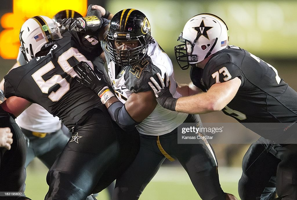 Missouri Tigers defensive lineman Michael Sam (52) pushes past the block of Vanderbilt Commodores offensive linesman Chase White (73) in the second quarter at Vanderbilt Stadium in Nashville, Tennessee, Saturday, October 5, 2013.