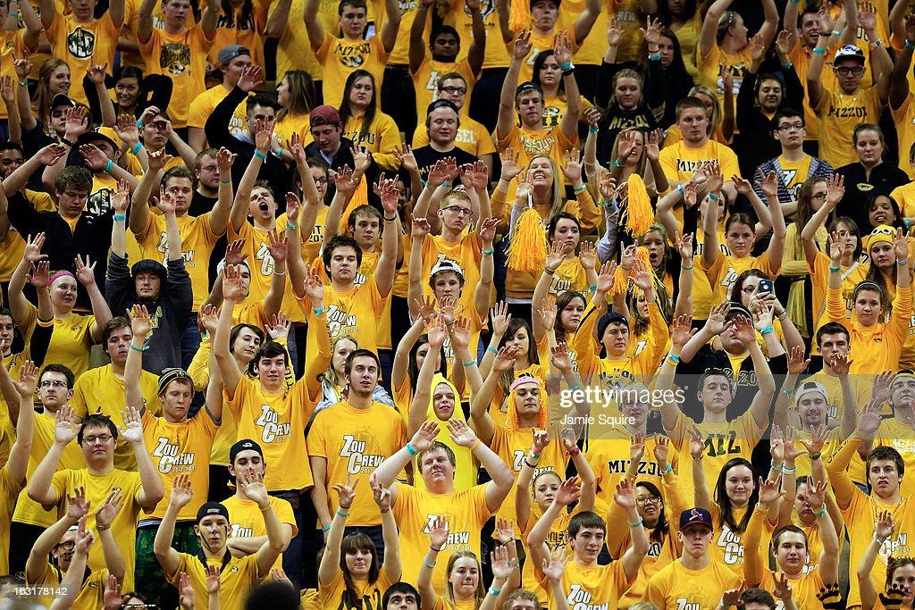 Missouri Tigers fans raise their arms during a free throw during the game against the Arkansas Razorbacks at Mizzou Arena on March 5, 2013 in Columbia, Missouri.