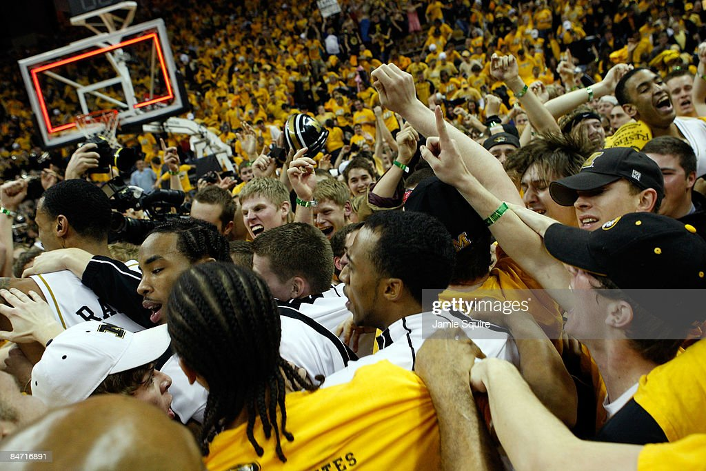 Missouri Tigers fans storm the court to celebrate with players after the Tigers defeated the Kansas Jayhawks 6260 on February 9 2009 at Mizzou Arena...