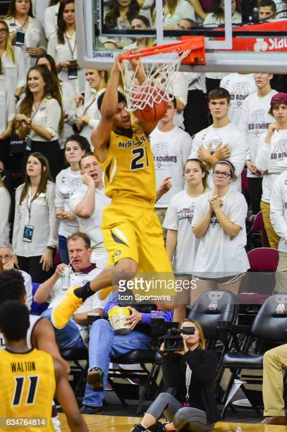 Missouri Tigers forward Jordan Barnett finishes a fast break off with a huge second half slam dunk during the SEC Men's basketball game between the...