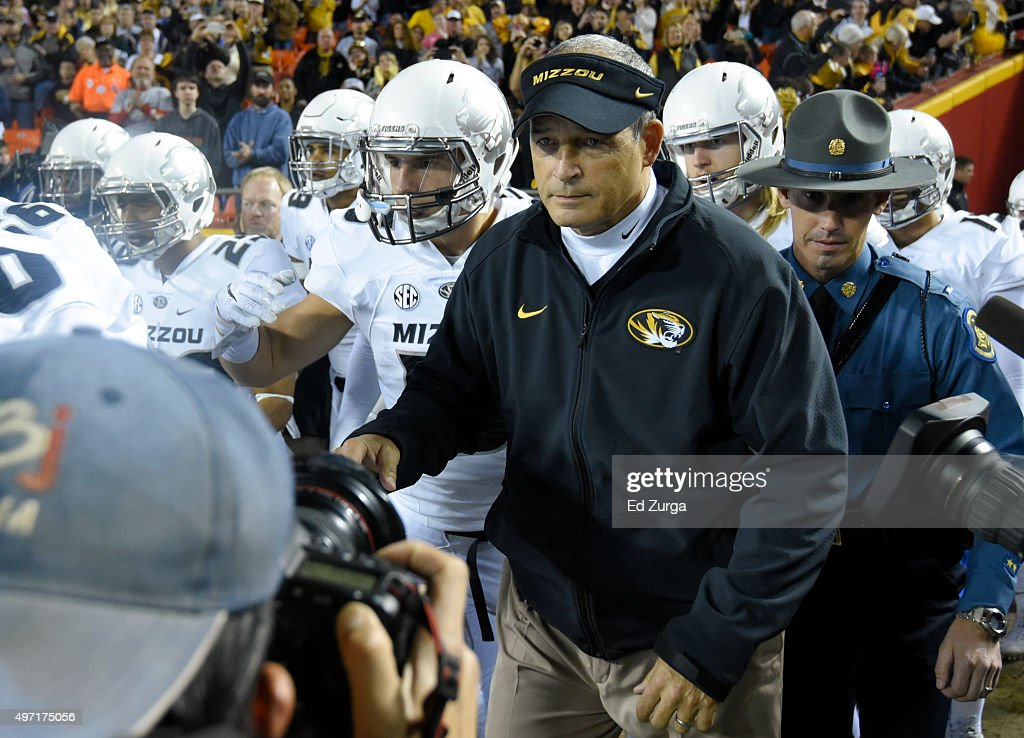 Missouri Tigers head coach <a gi-track='captionPersonalityLinkClicked' href=/galleries/search?phrase=Gary+Pinkel&family=editorial&specificpeople=2109950 ng-click='$event.stopPropagation()'>Gary Pinkel</a> leads his team onto the field prior to a game against the Brigham Young Cougars at Arrowhead Stadium on November 14, 2015 in Kansas City, Missouri.