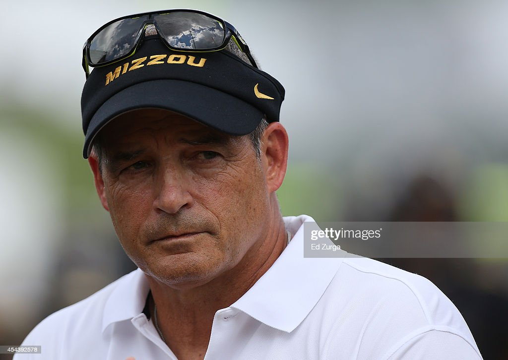 Missouri Tigers head coach <a gi-track='captionPersonalityLinkClicked' href=/galleries/search?phrase=Gary+Pinkel&family=editorial&specificpeople=2109950 ng-click='$event.stopPropagation()'>Gary Pinkel</a> watches his team warm up prior to a game against the South Dakota State Jackrabbits at Memorial Stadium on August 30, 2014 in Columbia, Missouri.