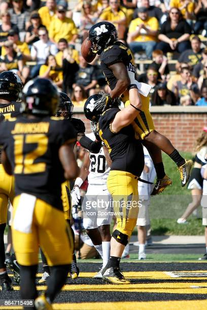 Missouri Tigers offensive lineman Samson Bailey lifts running back Ish Witter into the air after Witter scored a touchdown during the first half of a...