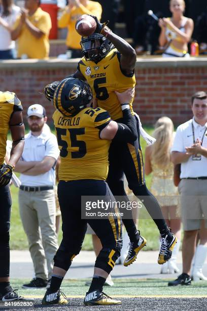 Missouri Tigers offensive lineman Trystan Castillo lifts wide receiver J'Mon Moore into the air after Moore scored a touchdown during the first half...