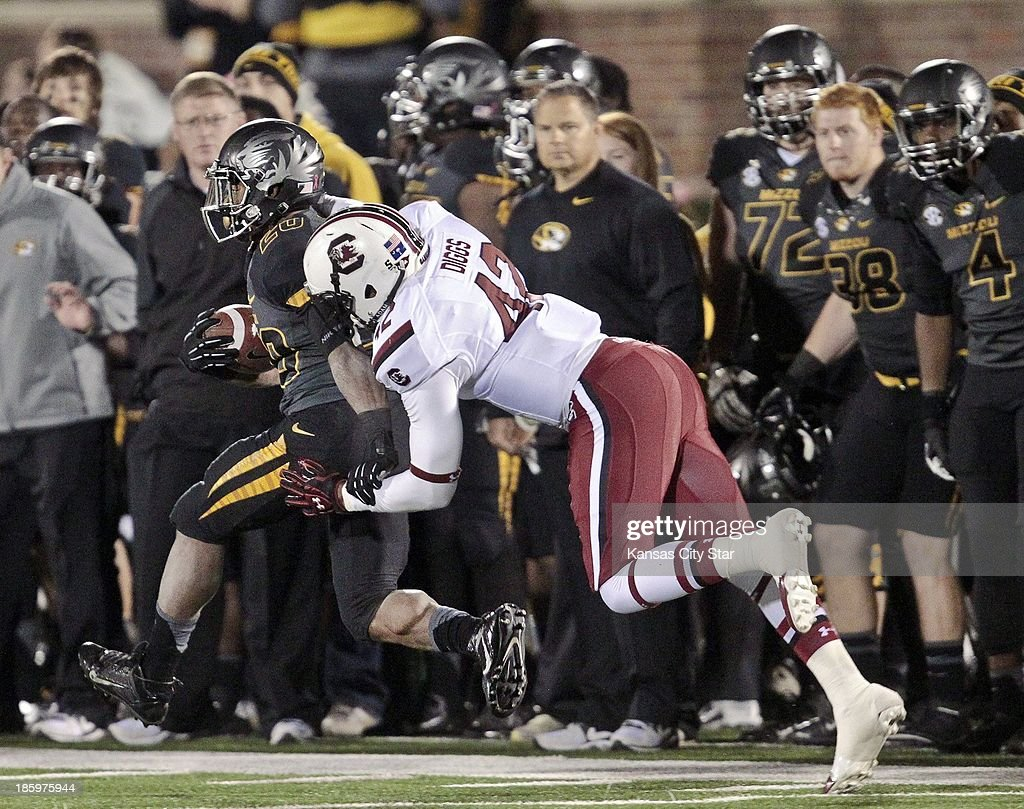 Missouri Tigers running back Henry Josey (20) stays ahead of South Carolina Gamecocks linebacker Jordan Diggs (42) during the first half at Memorial Stadium's Faurot Field in Columbia, Missouri, on Saturday, October 26, 2013.
