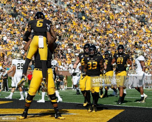 Missouri Tigers wide receiver J'Mon Moore is hoisted into the air by a teammate after scoring a touchdown during the first half of a football game...