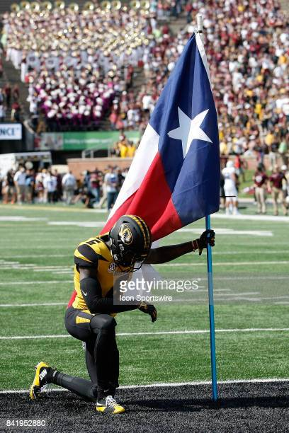 Missouri Tigers wide receiver J'Mon Moore kneels with a Texas state flag prior to the start of a football game against the Missouri State Bears...