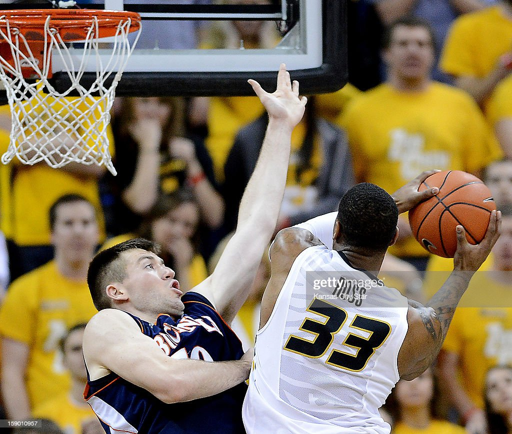 Missouri's Earnest Ross (33) drives hard to the basket against Bucknell's Brian Fitzpatrick in the second half at Mizzou Arena in Columbia, Missouri, Saturday, January 5, 2013. Missouri beat Bucknell, 66-64.