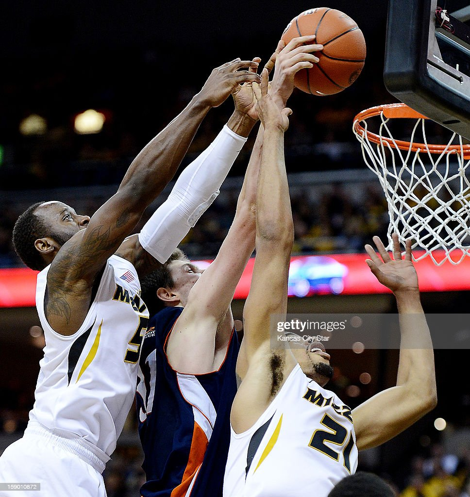 Missouri's Keion Bell, left, and Laurence Bowers, right, battle Bucknell's Mike Muscala for a rebound in the second half at Mizzou Arena in Columbia, Missouri, Saturday, January 5, 2013. Missouri beat Bucknell, 66-64.