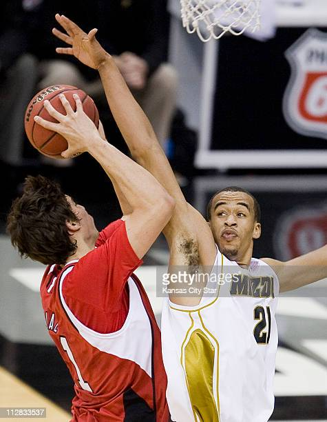 Missouri's Laurence Bowers defends as Nebraska's Brian Diaz takes a shot in the men's Big 12 Championship tournament at the Sprint Center in Kansas...