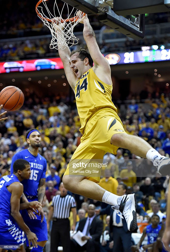 Missouri's Ryan Rosburg throws down a twohander much to the displeasure of Kentucky's Arron Harrison and Willie CauleyStein rear during the first...