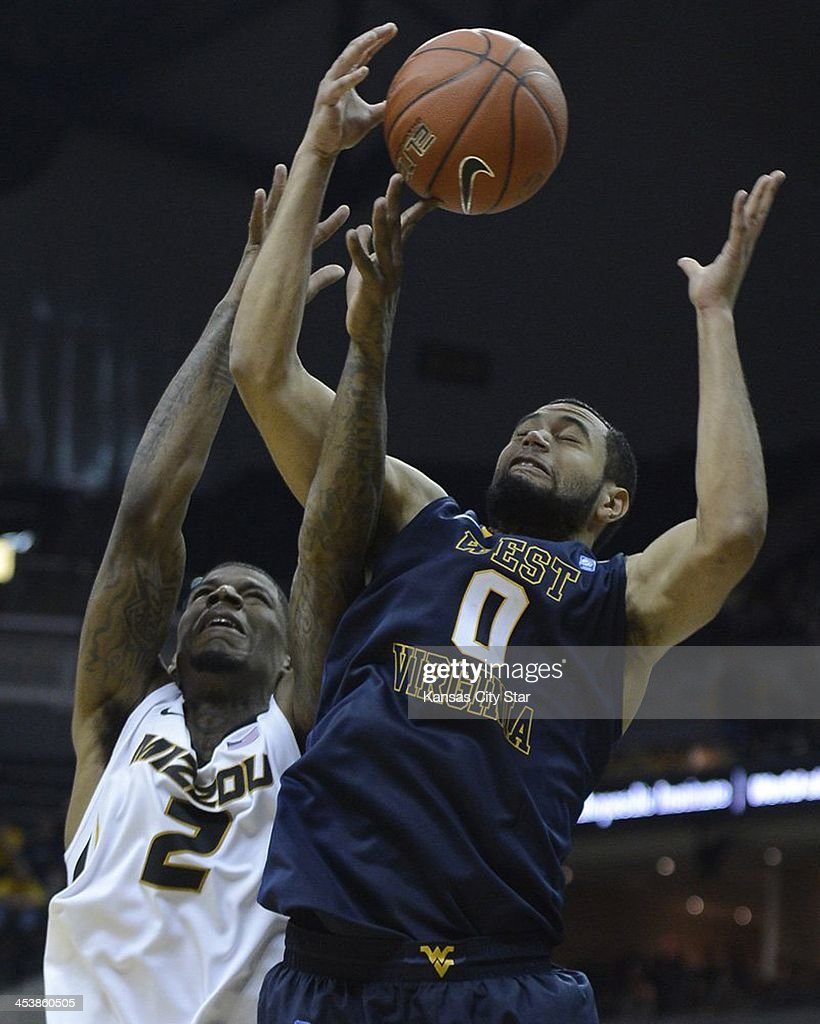 Missouri's Tony Criswell (2) battles West Virginia's Remi Dibo for a rebound during the first half at Mizzou Arena in Columbia, Mo., on Thursday, Dec. 5, 2013. Missouri won, 80-71.
