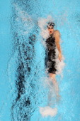 Missy Franklin competes in preliminary heat 16 of the Women's 100 m Backstroke during Day Two of the 2012 US Olympic Swimming Team Trials at...