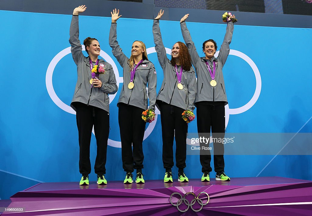 <a gi-track='captionPersonalityLinkClicked' href=/galleries/search?phrase=Missy+Franklin&family=editorial&specificpeople=6623958 ng-click='$event.stopPropagation()'>Missy Franklin</a>, <a gi-track='captionPersonalityLinkClicked' href=/galleries/search?phrase=Dana+Vollmer&family=editorial&specificpeople=240582 ng-click='$event.stopPropagation()'>Dana Vollmer</a>, <a gi-track='captionPersonalityLinkClicked' href=/galleries/search?phrase=Shannon+Vreeland&family=editorial&specificpeople=6738252 ng-click='$event.stopPropagation()'>Shannon Vreeland</a>, and <a gi-track='captionPersonalityLinkClicked' href=/galleries/search?phrase=Allison+Schmitt&family=editorial&specificpeople=4443033 ng-click='$event.stopPropagation()'>Allison Schmitt</a> of the United States celebrate the medal ceremony for the Women's 4x200m Freestyle Relay on Day 5 of the London 2012 Olympic Games at the Aquatics Centre on August 1, 2012 in London, England.