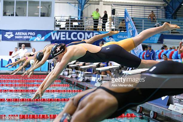 Missy Franklin dives into the water at the start of the Women 50 LC meter freestyle prelims during day two of the Arena Pro Swim Series at the YMCA...
