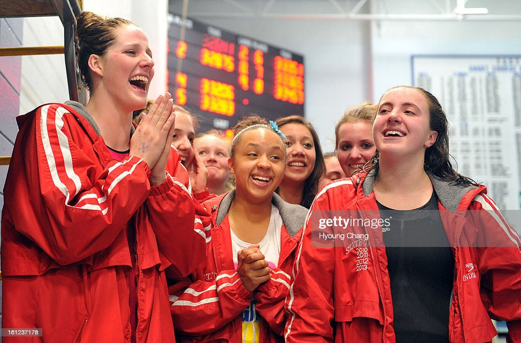 Missy Franklin, left, and Regis Jesuit High School swimmers show emotion after the winning of 5A state Championship on February 9, 2013 at Edora Pool Ice Center in Fort Collins, Colorado.