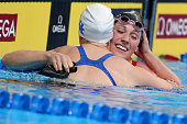 Missy Franklin of the United States celebrates with Bridgette Alexander of the United States after competing in a semifinal heat for the Women's 200...