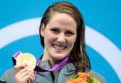 Missy Franklin of the United States celebrates with her gold medal during the medal ceremony for the Women's 100m Backstroke on Day 3 of the London...