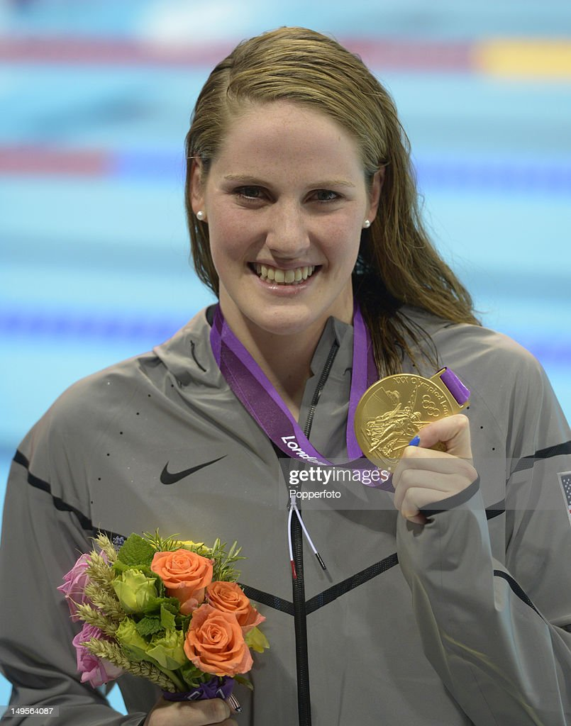 <a gi-track='captionPersonalityLinkClicked' href=/galleries/search?phrase=Missy+Franklin&family=editorial&specificpeople=6623958 ng-click='$event.stopPropagation()'>Missy Franklin</a> of the United States celebrates with her gold medal during the medal ceremony for the Women's 100m Backstroke on Day 3 of the London 2012 Olympic Games at the Aquatics Centre on July 30, 2012 in London, England.
