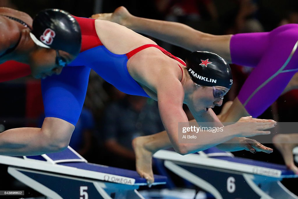 <a gi-track='captionPersonalityLinkClicked' href=/galleries/search?phrase=Missy+Franklin+-+Swimmer&family=editorial&specificpeople=6623958 ng-click='$event.stopPropagation()'>Missy Franklin</a> of the United States dives in to compete in a heat for the Women's 100 Meter Freestyle during Day Five of the 2016 U.S. Olympic Team Swimming Trials at CenturyLink Center on June 30, 2016 in Omaha, Nebraska.