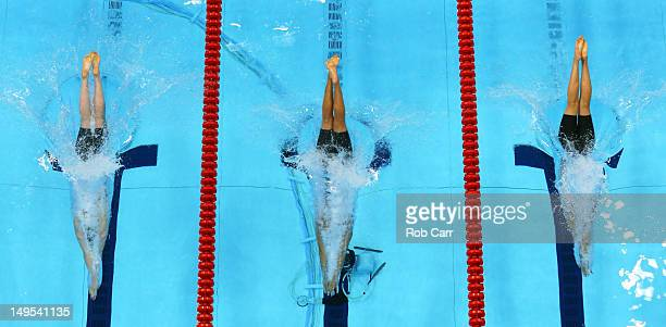 Missy Franklin of the United States Federica Pellegrini of Italy and Melania Costa Schmid of Spain dive in the pool as they compete in the second...