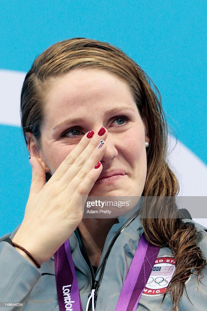 <a gi-track='captionPersonalityLinkClicked' href=/galleries/search?phrase=Missy+Franklin+-+Swimmer&family=editorial&specificpeople=6623958 ng-click='$event.stopPropagation()'>Missy Franklin</a> of the United States wipes a tear from her face as she reacts during the medal ceremony for the Women's 100m Backstroke on Day 3 of the London 2012 Olympic Games at the Aquatics Centre on July 30, 2012 in London, England.