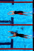 Missy Franklin of the USA and Hilary Caldwell of Canada compete during the Swimming Women's Backstroke 200m Semifinal heat 2 on day fourteen of the...