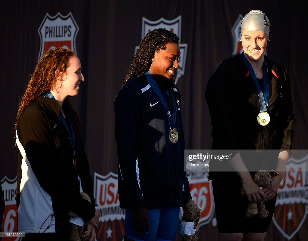 <a gi-track='captionPersonalityLinkClicked' href=/galleries/search?phrase=Missy+Franklin+-+Swimmer&family=editorial&specificpeople=6623958 ng-click='$event.stopPropagation()'>Missy Franklin</a>, <a gi-track='captionPersonalityLinkClicked' href=/galleries/search?phrase=Simone+Manuel&family=editorial&specificpeople=10964803 ng-click='$event.stopPropagation()'>Simone Manuel</a> and <a gi-track='captionPersonalityLinkClicked' href=/galleries/search?phrase=Shannon+Vreeland&family=editorial&specificpeople=6738252 ng-click='$event.stopPropagation()'>Shannon Vreeland</a> react on the podium to their first, second and third place in the Women's 100 Meter Freestyle Final during the 2014 Phillips 66 National Championships at the Woollett Aquatic Center on August 6, 2014 in Irvine, California.