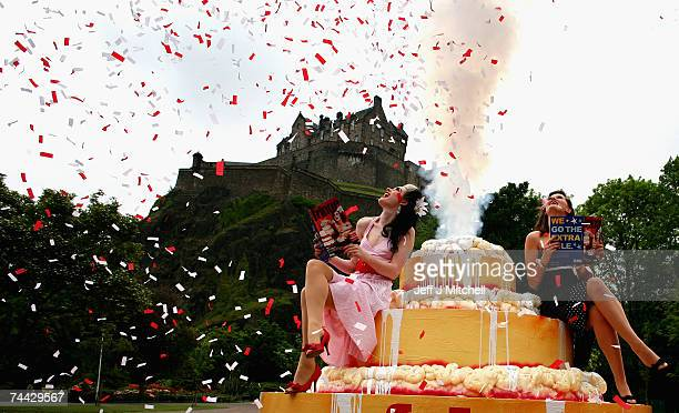 Missy Malone and Naomi Howarth sit on a giant cake at the launch of the 2007 Edinburgh Fringe Festival programme June 7 2007 in Edinburgh Scotland...