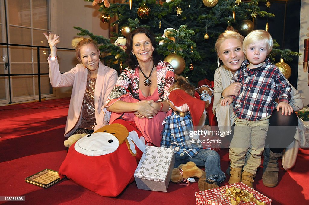 Missy May, Maya Hakvoort and Niko Fechter with son Theo attend the Christmas ball for children Energy For Life - Heat For Children's Hearts at Hofburg Vienna on December 11, 2012 in Vienna, Austria.