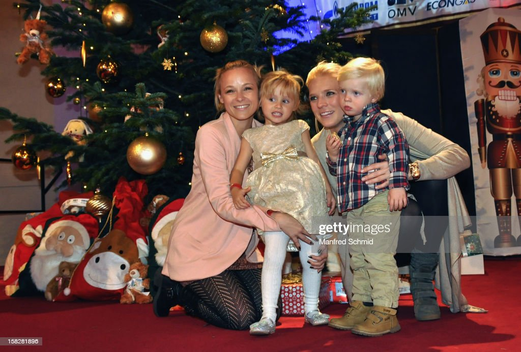 Missy May with daughter Marie, Niko Fechter with son Theo attend the Christmas ball for children Energy For Life - Heat For Children's Hearts at Hofburg Vienna on December 11, 2012 in Vienna, Austria.