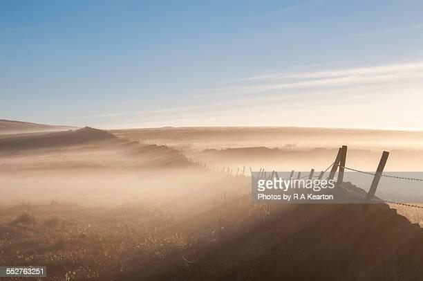 Mist drifting over a wall on the moors
