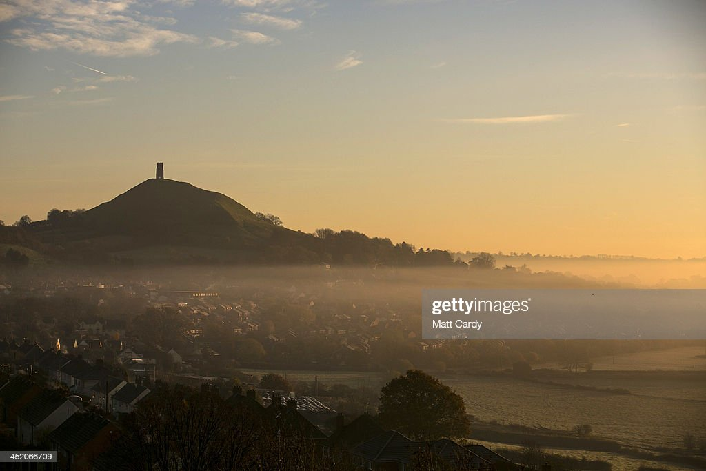 Mist lingers around Glastonbury Tor as the early morning sun rises on November 26, 2013 in Glastonbury, England. After a later than normal autumn and as the UK heads towards the meteorological winter, which spans the entirety of December, January, and February, weather forecasters are predicting a drop in temperatures, with more wintry weather due with a mix of fog, overnight frost, some scattered showers, as well as some sunny spells.