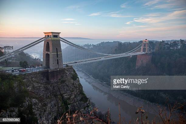 Mist lingers behind the Clifton Suspension Bridge as the sun begins to rise in Bristol on January 24 2017 in Bristol United Kingdom The Met Office...