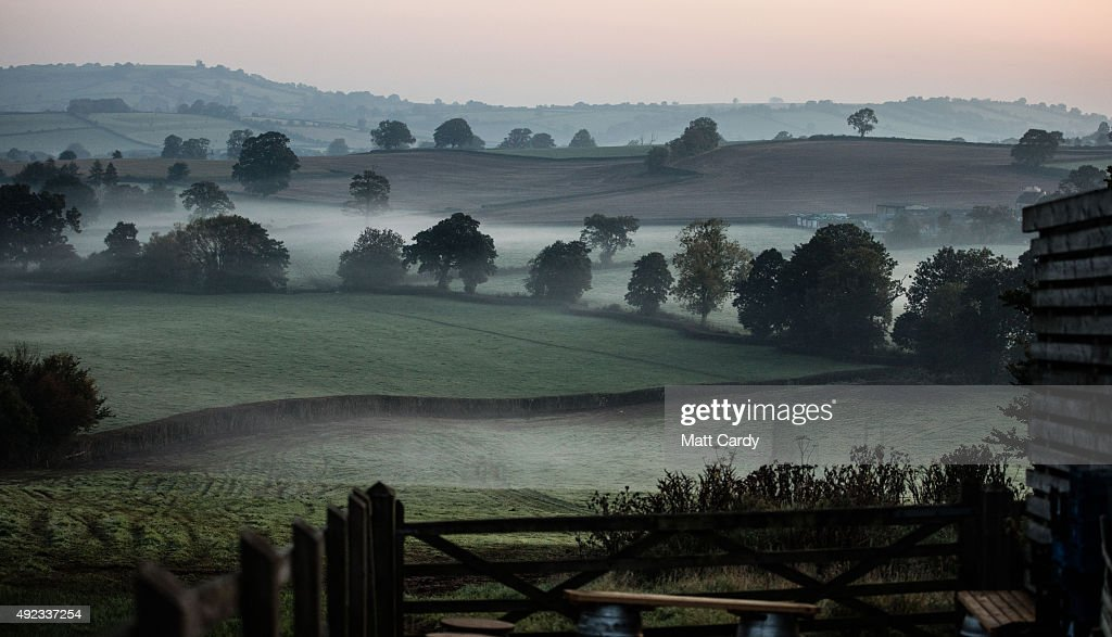 Mist lingers in fields near Bristol as the sun begins to rise on October 12, 2015 in Bristol, England. Parts of the UK are set to have a period of settled weather once again due to a high pressure system leading to a number of fine and dry days for some.