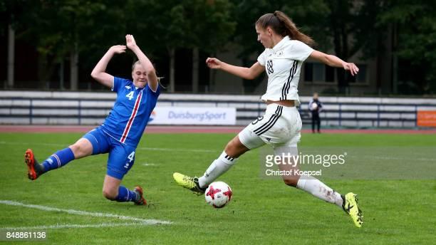 Mist Pormooesdottir of Iceland challenges Melissa Koessler of Germany during the UEFA Under19 Women's Euro Qualifier match between Germany and...