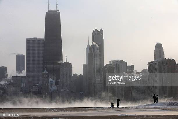 Mist rises from Lake Michigan at North Avenue Beach as temperatures dipped well below zero on January 6 2014 in Chicago Illinois Chicago hit a record...
