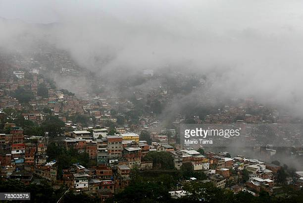 Mist rises over the poor barrio of Petare after opposition supporters defeated a referendum on changes to the Constitution proposed by Venezuelan...