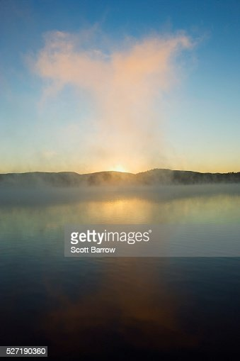 Mist rising from a lake : Stock-Foto