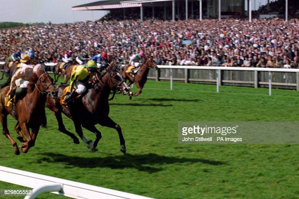 Mister Baileys with Jason Weaver up centre winning the Madagans 2000 Guineas Stakes at Newmarket from Grand Lodge left ridden by Frankie Dettori