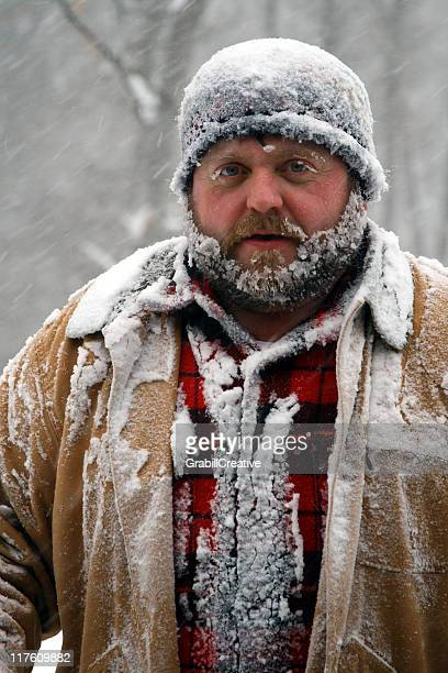 Mister Frosty Man Covered in Snow During winter Storm