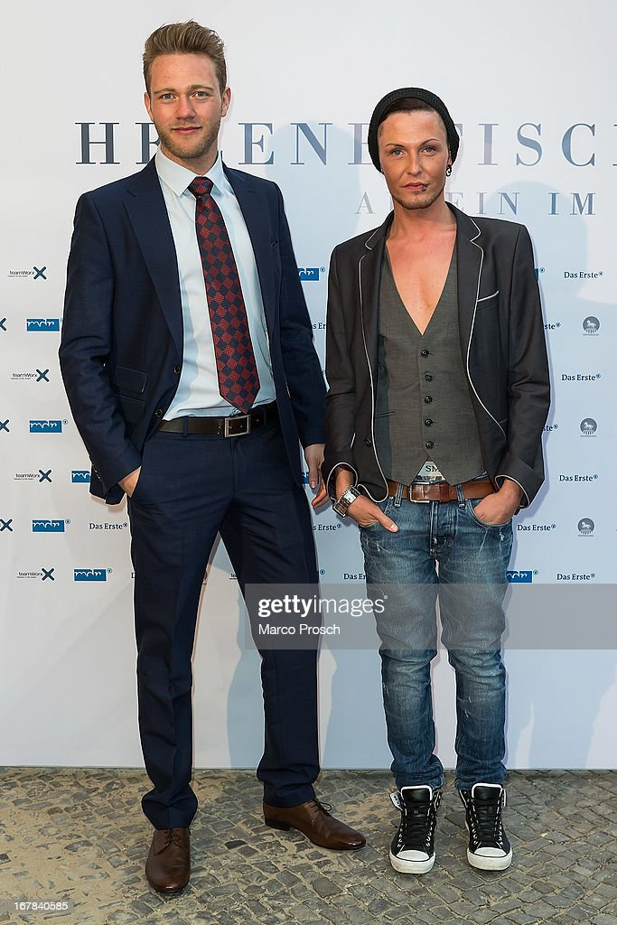 Mister Germany 2013 Joern Kamphuis (L) and singer Marcel Gabriel (R) attend the premiere of the documentary 'Allein im Licht' ('Alone in the light') at the Babylon cinema on April 30, 2013 in Berlin, Germany.