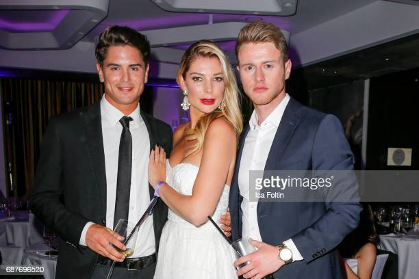 Mister Germany 2017 Dominik Bruntner model Annika Gassner and a male model during the Kempinski Fashion Dinner on May 23 2017 in Munich Germany