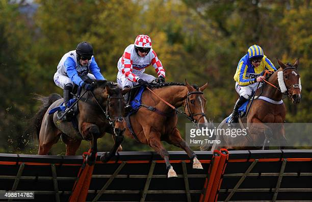 Mister Miyagi ridden by Ian Popham jumps the last to win the Setsquare Recruitment National Hunt Novices Hurdle at Taunton Racecourse on November 26...