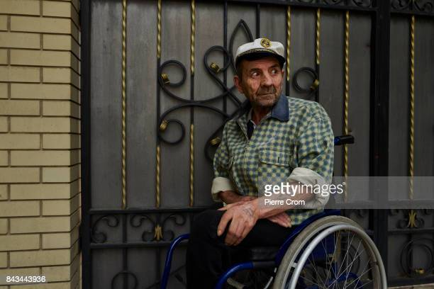Mister Vova Bakharnikov rests in front of his house on the frontline on September 06 2017 in Avdiivka Ukraine The frontlinecity Avdiivka is located...