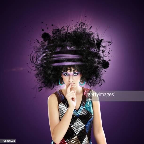 Misterious girl with finger on lips and funny hairstyle